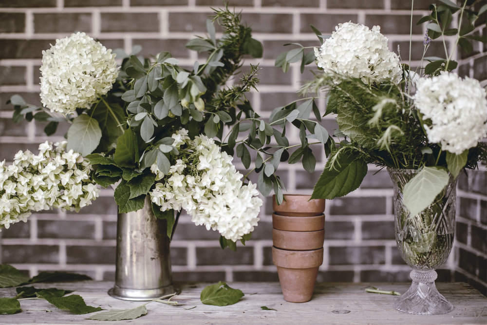 white and green farmhouse florals with hydrangea and herbs / heirloomed