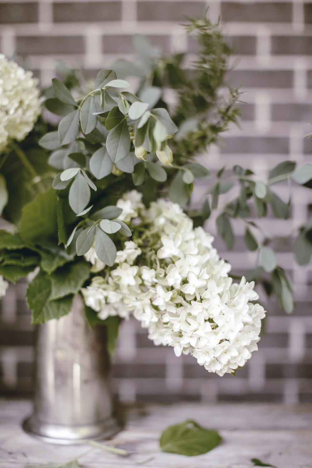 white hydrangea with herbs and greens / heirloomed