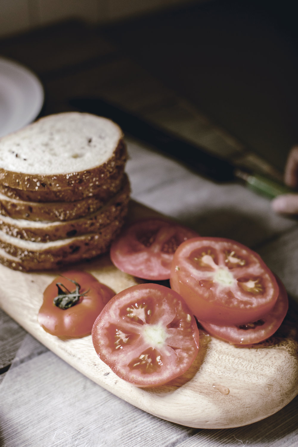 sliced tomatoes for a classic tomato sandwich / heirloomed