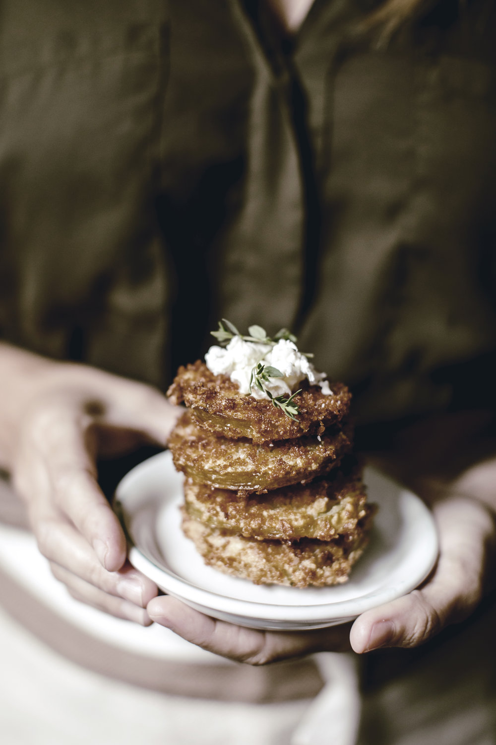 stack of garnished fried green tomatoes / heirloomed