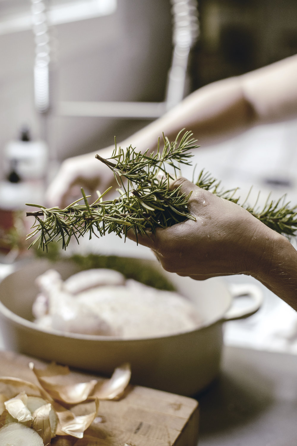 Seasoning a whole chicken with rosemary