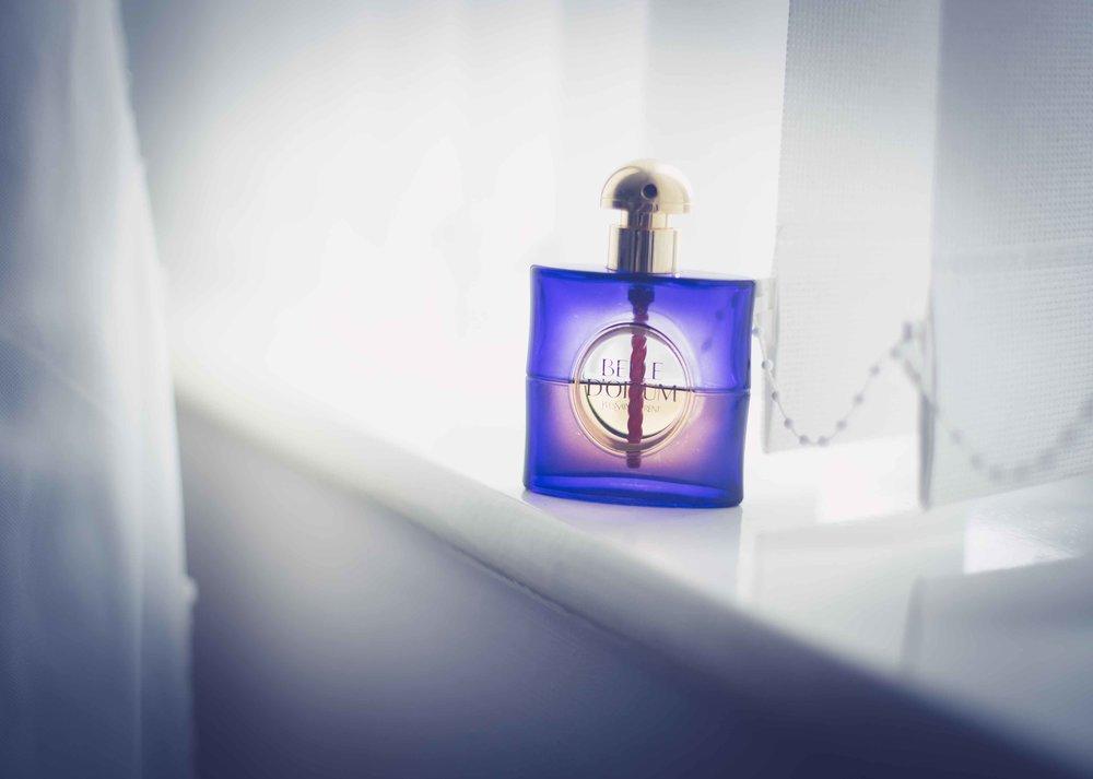 Opium Perfume on window