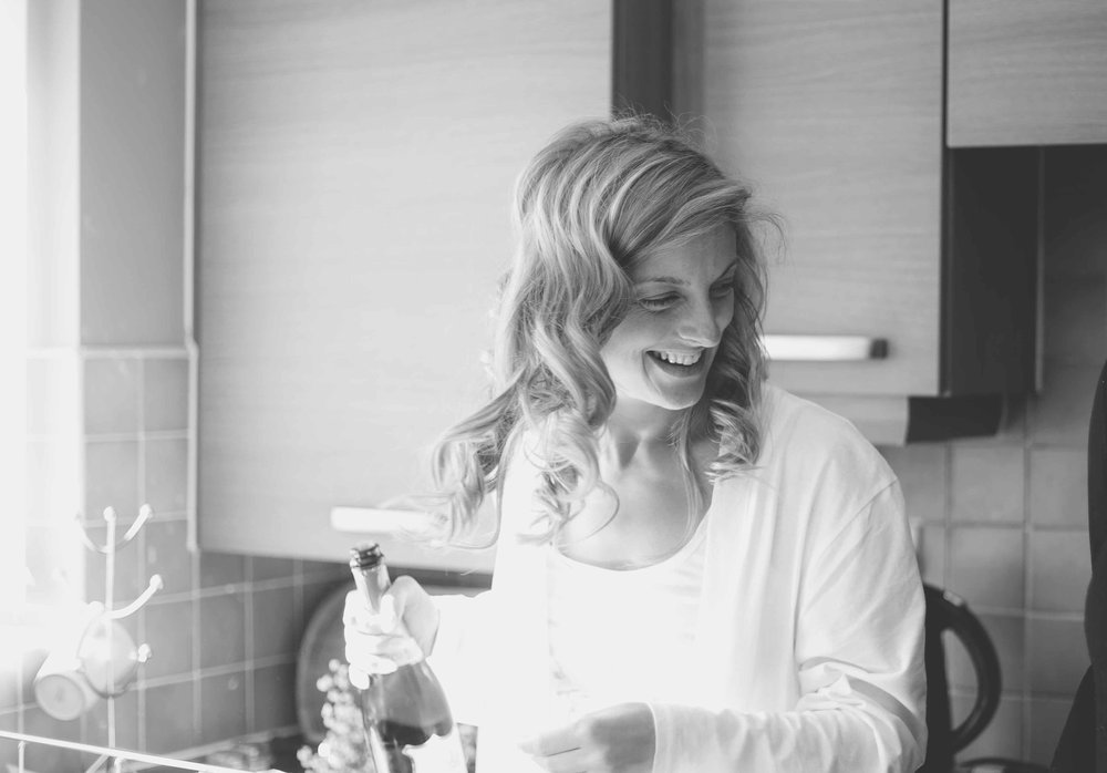 Bride Laughing with champagne
