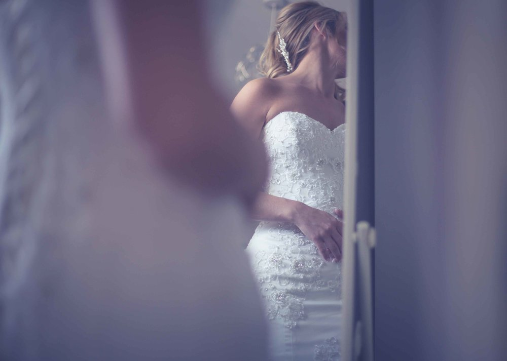Mirror reflection on wedding dress