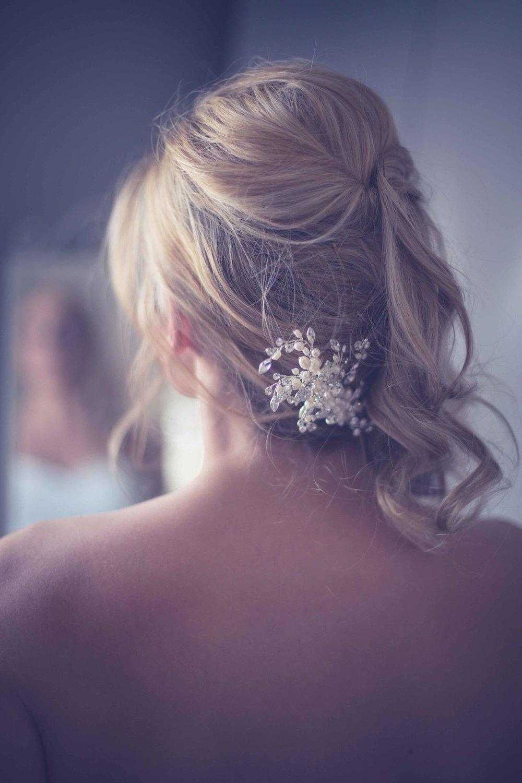 bridal hair in mirror