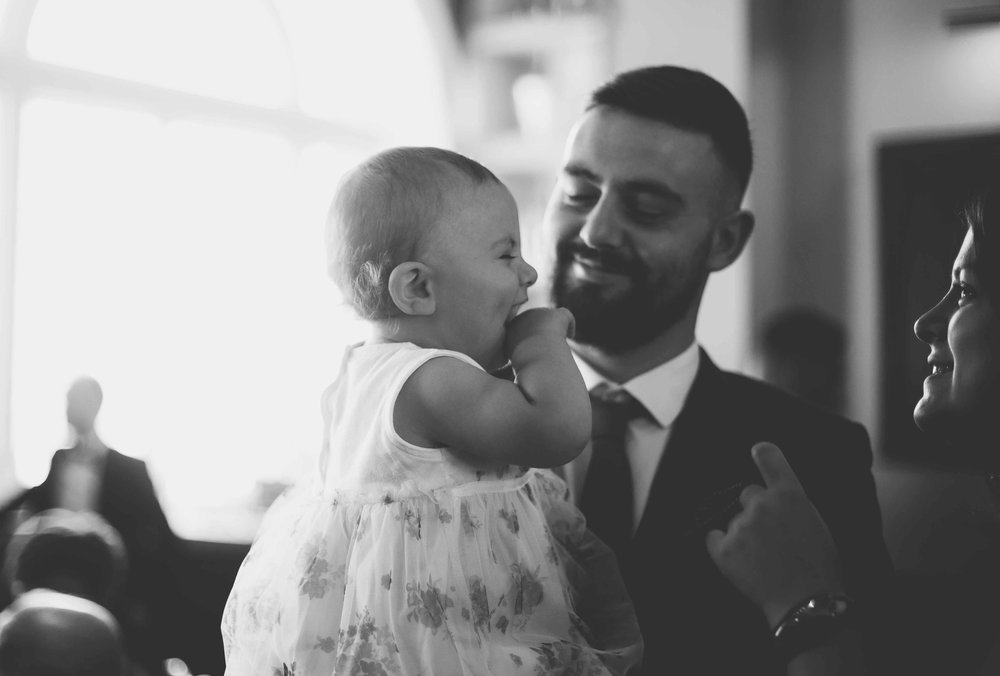 Dad with baby laughing