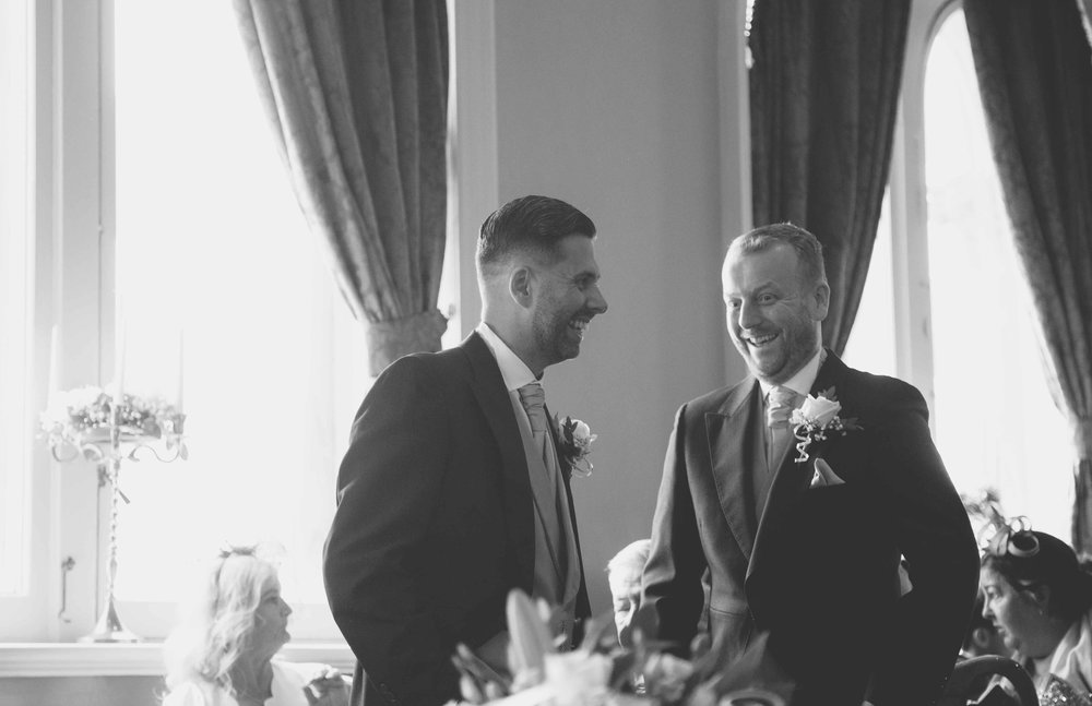 Groom and best man waiting