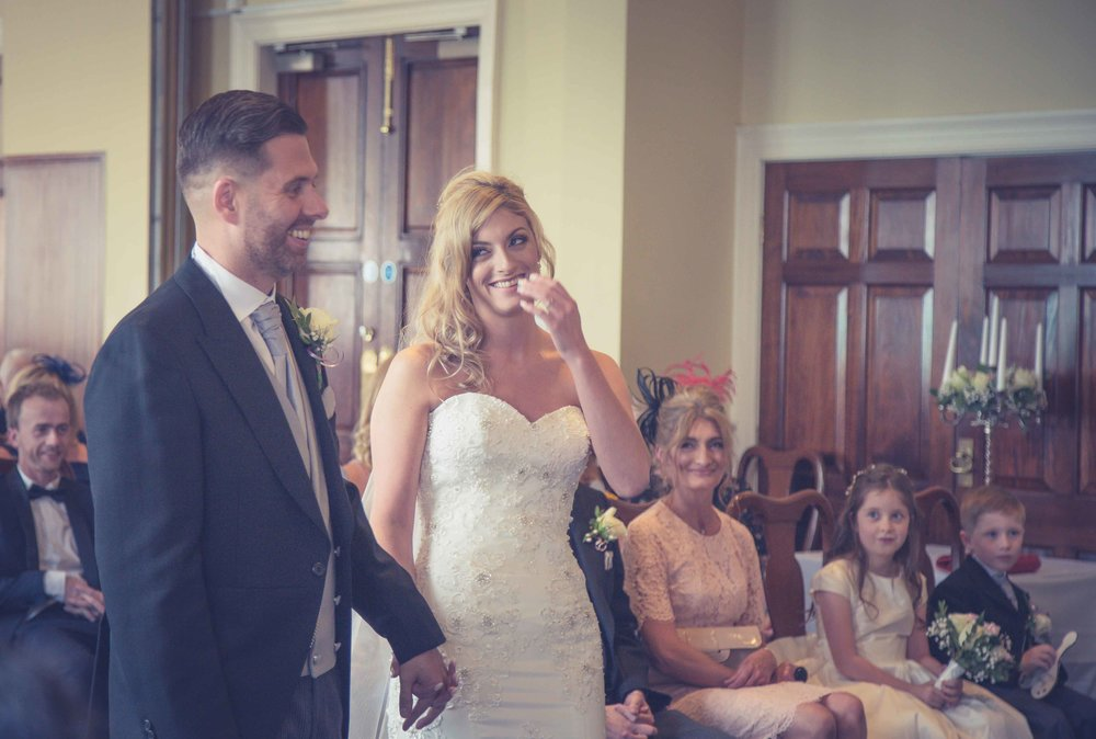 Couple laughing during ceremony