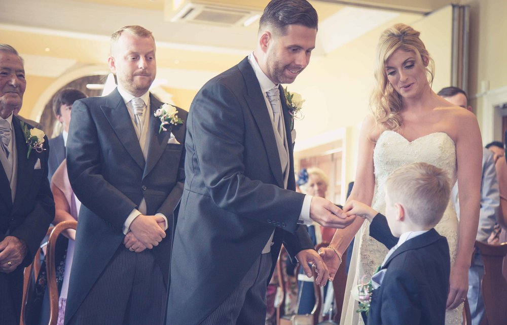 Page boy passing the rings to the groom