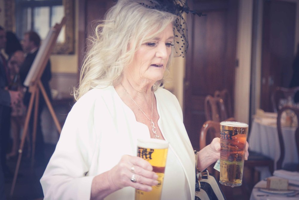 Nan of the bride with beers