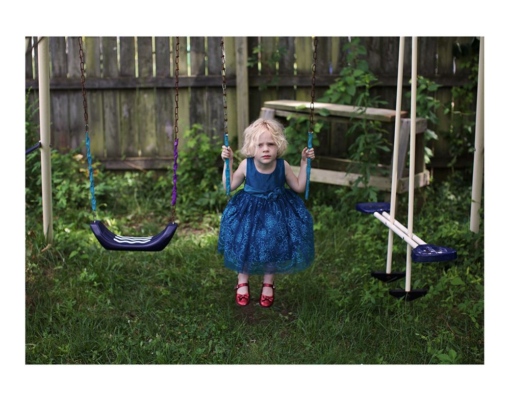Elena wanting to swing in her backyard.