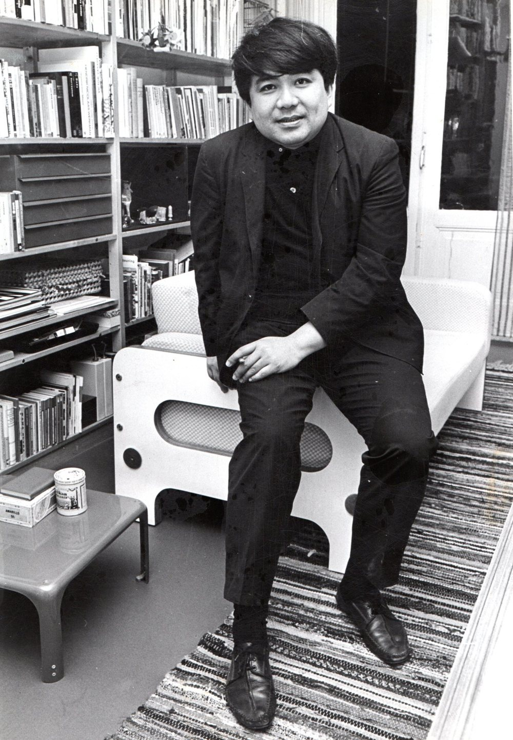 With sofa 115 in his living room. 1966