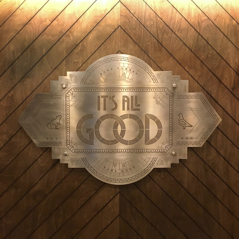 """Same number, same hood. It's all Good""   Engraved brass installation for WeWork 57th Street. nspired by NYC art deco buildings, subway rats and Biggie lyrics.  Art Direction by Jeremiah Britton, Interior Design by Alex Snyder"