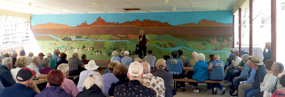 The stories of Grafton and Rockville, settlements near the entrance to Zion Canyon, are told to attendees by Leon Lewis, a life-long resident and community leader in the area. Please click to enlarge the photo.