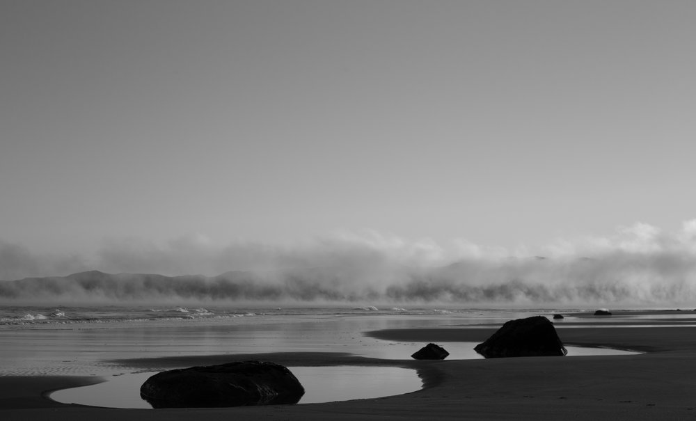 Sunrise Beach Fog Stones BW.jpg