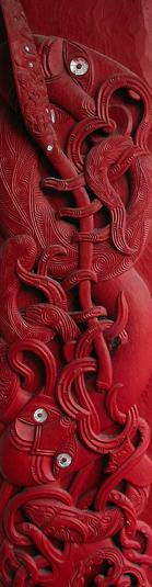 Maori carved house post from Tanenuiarangi meeting house, Waipapa marae, University of Auckland,depicting the navigator Kupe, holding a paddle to mark his prowess as a seafarer,an octopus (wheke), at his feet.  Photo  :Kahuroa. Public Domain.