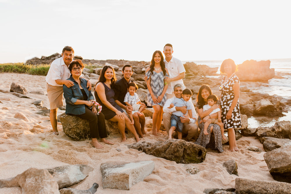 large generational family photos at sunset on the beach