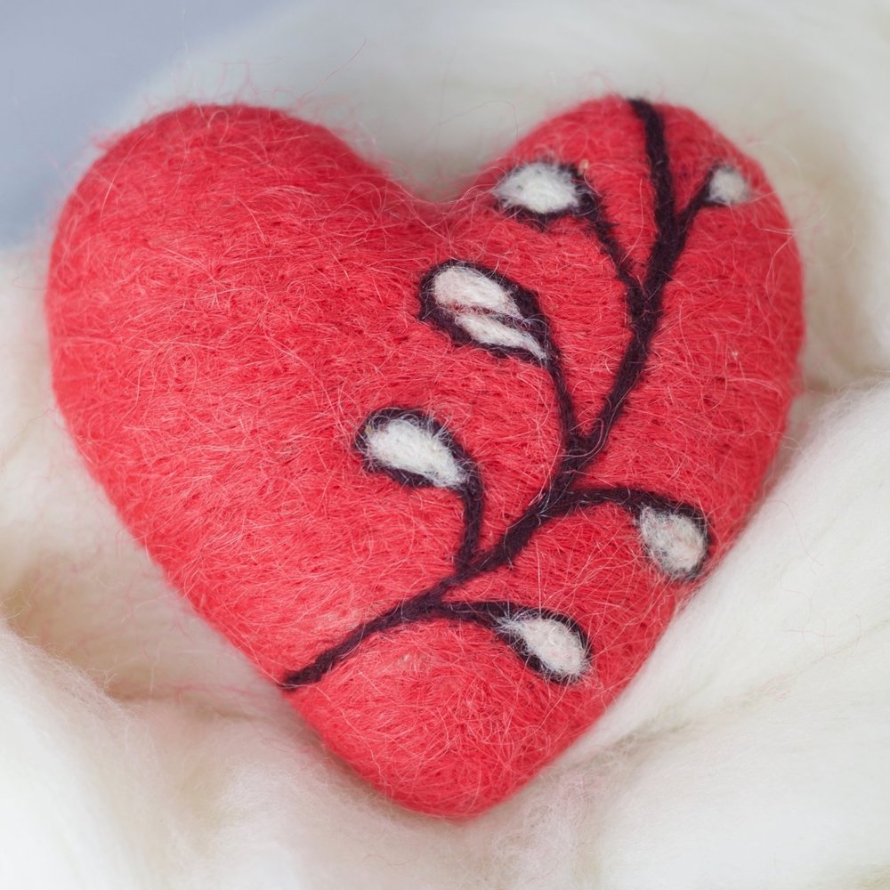 Let me teach you to poke wool into a heart-shaped thing!