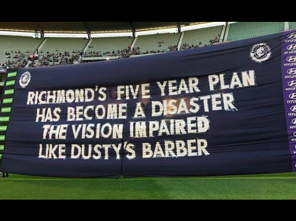 2017 vs. Richmond - My first banner for the AFL side and possibly the most infamous banner of the modern era. The banner that won Richmond a flag and Dusty a Brownlow (and almost sunk my banner writing career before it even really started). Fans found it hilarious, but many humourless media types like Damien Barrett and Craig Hutchison called for my 'sacking'. It's a big piece of crete paper guys. Relax. A number of 'sports journalists' did some half-assed research on who wrote it, as a made up story soon circled that 'the club had hired and paid a PR Firm to write the banners'. Such is the state of modern journalism. Regardless, it's still pretty funny.