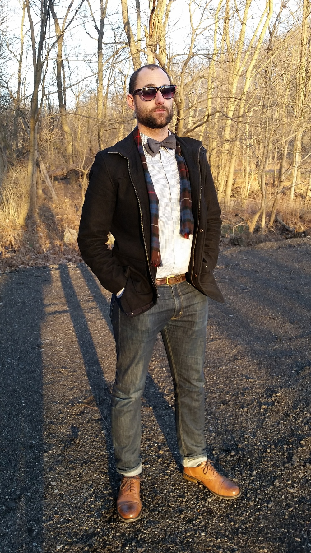 My super-handsome husband (seriously, look at that guy!) is wearing: Five Below sunglasses stolen from me, Levi's 513 jeans, bow tie from  The Tie Bar , shoes by Steve Madden, Uniqlo shirt, Kenneth Cole Reaction coat, thrifted belt.