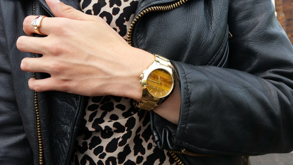 I treated myself to this gorgeous gold-plated Coach watch with a tiger's eye face last month. It's sold out on the Jared the Galleria website now, but you can still find it at   Macy's.   The ring is Eric's grandfather's wedding ring.