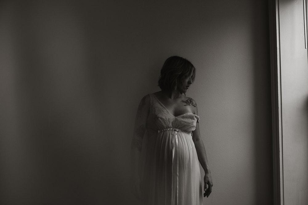 kenzi-maternity-woman-in-vintage-gown-by-window-iowa-raelyn-ramey-photography-96.jpg