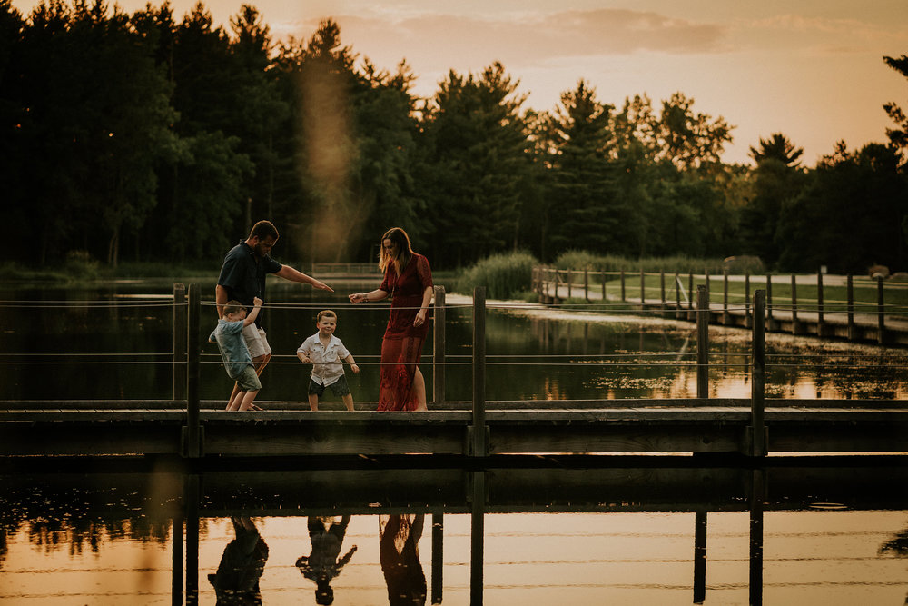 flynn-family-dancing-on-bridge-jester-park-iowa-raelyn-ramey-photography.jpg.jpg