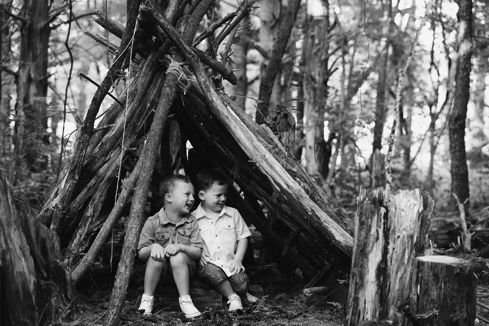 flynn-family-kid-boys-under-teepee-jester-park-iowa-raelyn-ramey-photography.jpg