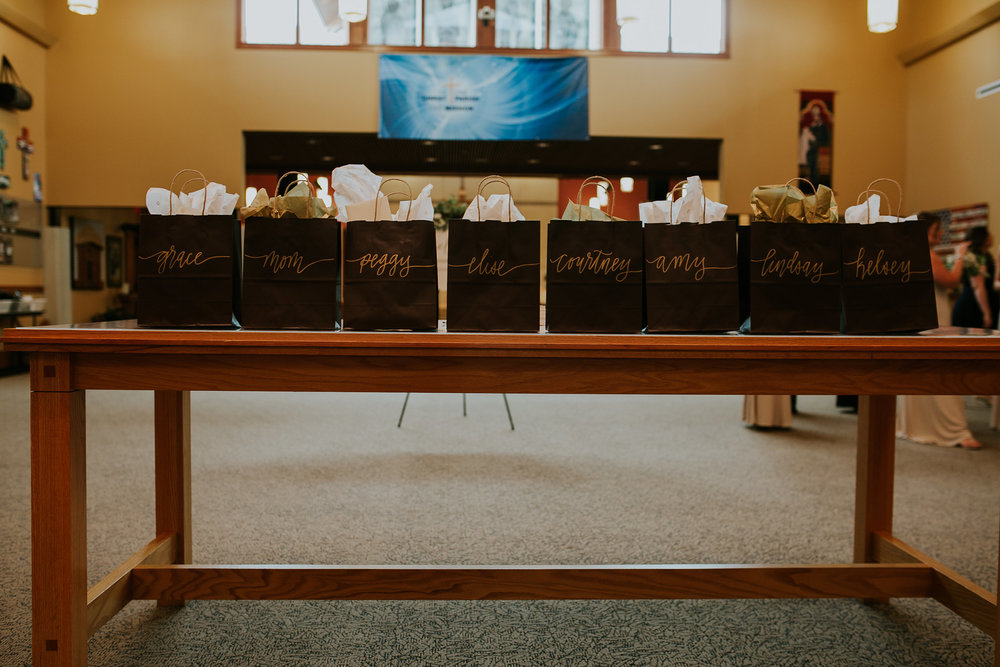 mr-mrs-hull-bride-giftbags-for-bridesmaids-st-boniface-church-waukee-desmoines-iowa-raelyn-ramey-photography-187.jpg
