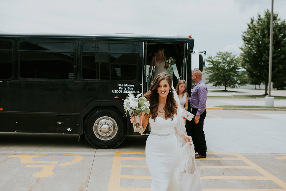 mr-mrs-hull-bride-walking-off-bus-desmoines-iowa-raelyn-ramey-photography-178.jpg