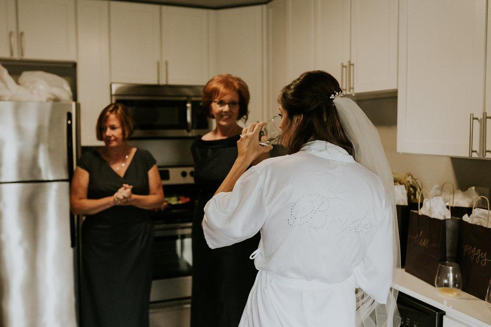 mr-mrs-hull-bride-wearing-robe-desmoines-iowa-raelyn-ramey-photography-56.jpg