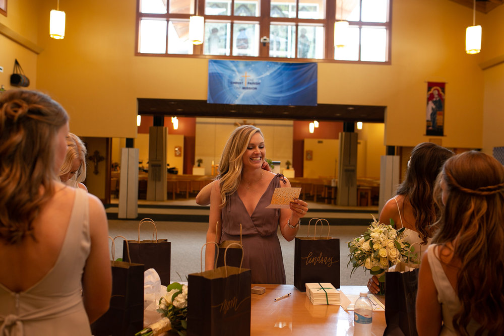 mr-mrs-hull-bridesmaid-opening-gifts-st-boniface-church-waukee-desmoines-iowa-raelyn-ramey-photography-198.jpg