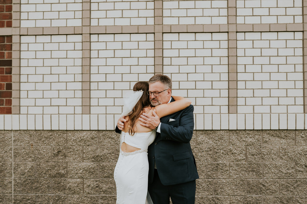 mr-mrs-hull-dad-hugging-bride-st-boniface-waukee-desmoines-iowa-raelyn-ramey-photography-275.jpg