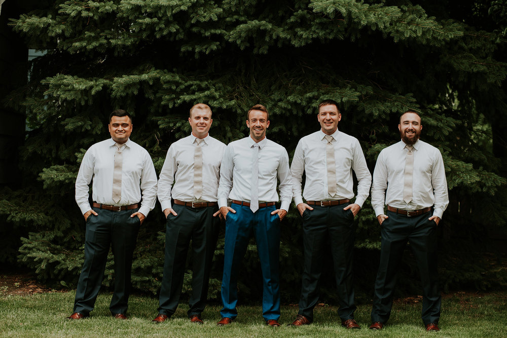 mr-mrs-hull-groom-posing-with-groomsmen-desmoines-iowa-raelyn-ramey-photography-148.jpg