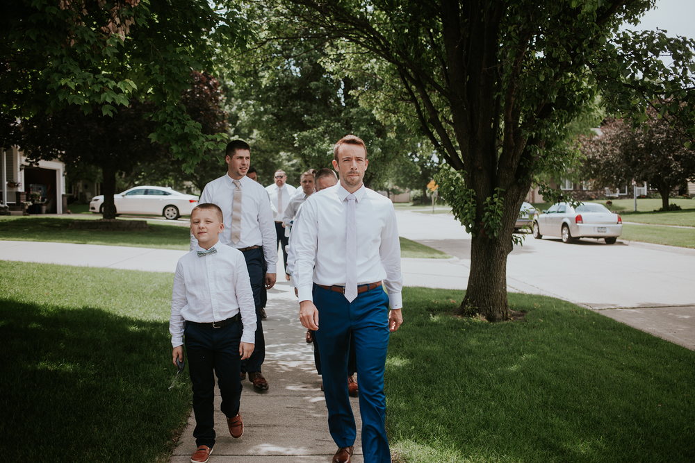 mr-mrs-hull-groomsmen-walking-desmoines-iowa-raelyn-ramey-photography-138.png