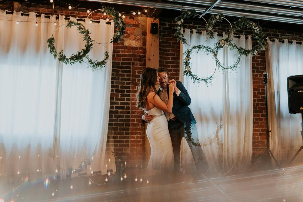 mr-mrs-hull-wedding-bride-groom-first-dance-iowa-taproom-love-desmoines-iowa-raelyn-ramey-photography-583.jpg