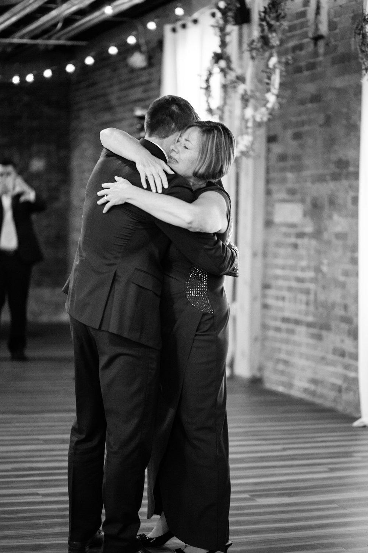 mr-mrs-hull-wedding-groom-mother-dance-iowa-taproom-desmoines-iowa-raelyn-ramey-photography-619.jpg