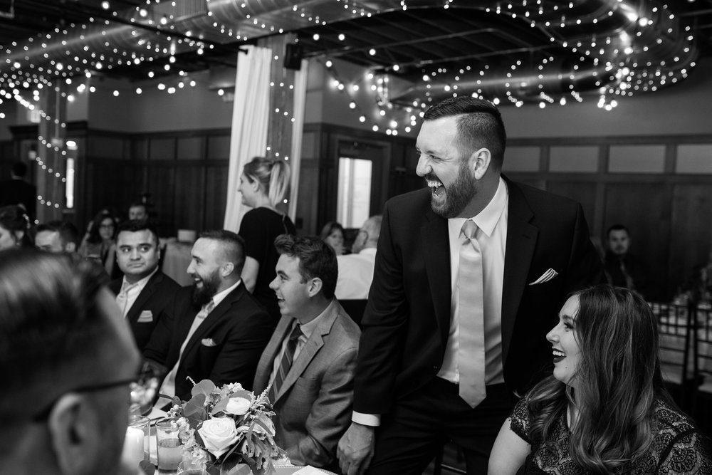 mr-mrs-hull-wedding-guest-laughing-iowa-taproom-desmoines-iowa-raelyn-ramey-photography-676.jpg
