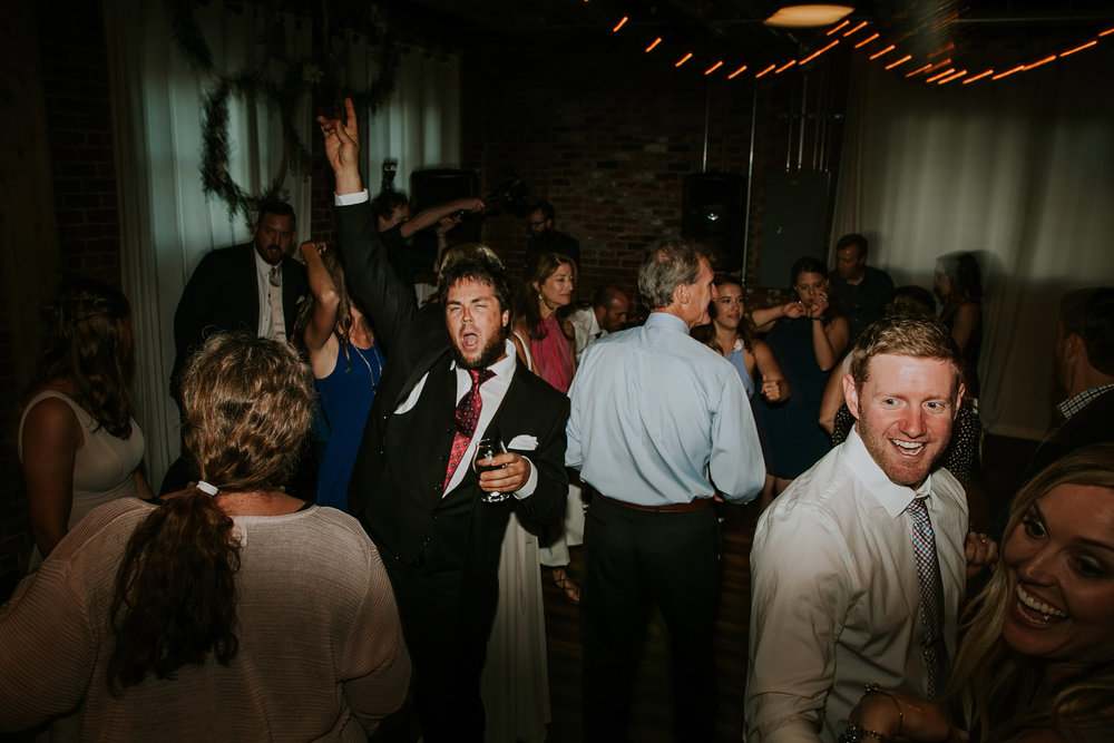mr-mrs-hull-wedding-guest-rocking-out-on-dance-floor-iowa-taproom-desmoines-iowa-raelyn-ramey-photography-754.jpg