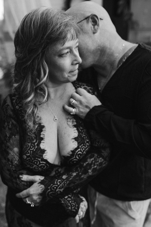 vintage-camper-mini-sessions-couple-holding-eachother-man-kissing-woman-shoulder-iris-aisle-winterset-iowa-raelyn-ramey-photography-187.jpg