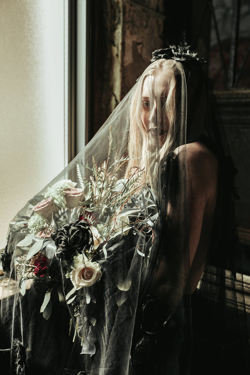bride-holding-flowers-under-black-veil-black-dress-burlington-iowa-gothic-wedding-elopement-raelyn-ramey-photography-113.jpg