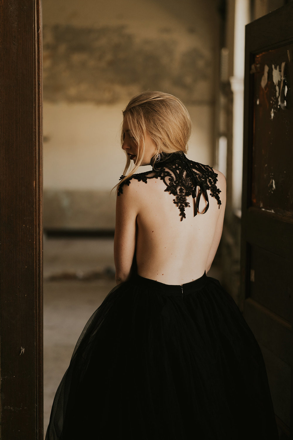 bride-showing-neck-piece-burlington-iowa-gothic-wedding-elopement-raelyn-ramey-photography-35.jpg