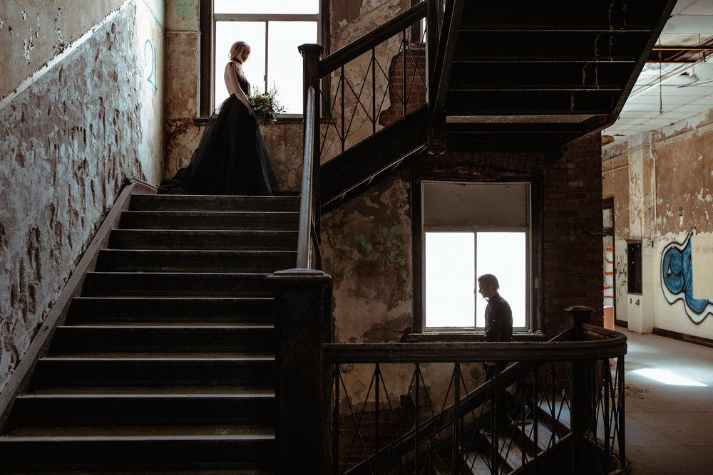 couple-first-look-standing-on-abandon-staircase-burlington-iowa-gothic-wedding-elopement-raelyn-ramey-photography-102.jpg
