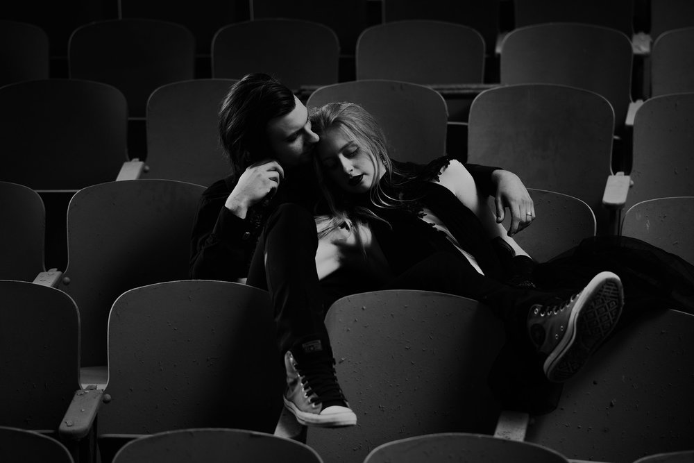 couple-sitting-in-abandon-school-theater-seats-burlington-iowa-gothic-wedding-elopement-raelyn-ramey-photography-213.jpg