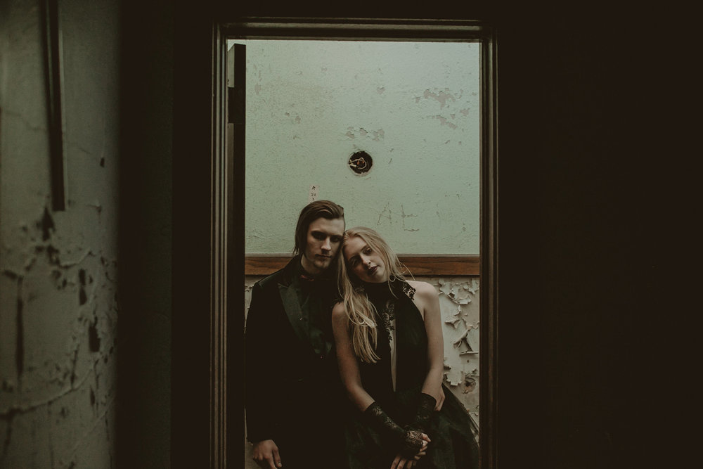couple-standing-in-abandon-school-burlington-iowa-gothic-wedding-elopement-raelyn-ramey-photography.jpg