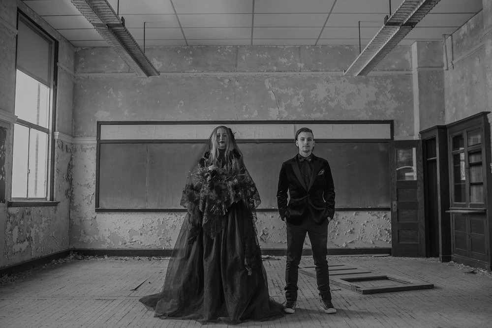 couple-standing-in-abandon-school-with-black-veil-burlington-iowa-gothic-wedding-elopement-raelyn-ramey-photography-219.jpg