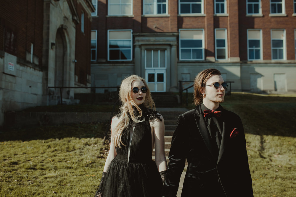 couple-with-round-sunglasses-burlington-iowa-gothic-wedding-elopement-raelyn-ramey-photography-243.jpg