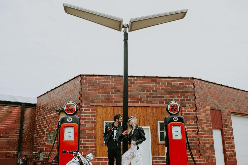 bride-groom-at-gas-station-iowa-road-trip-romance-wedding-raelyn-ramey-photography-100.jpg