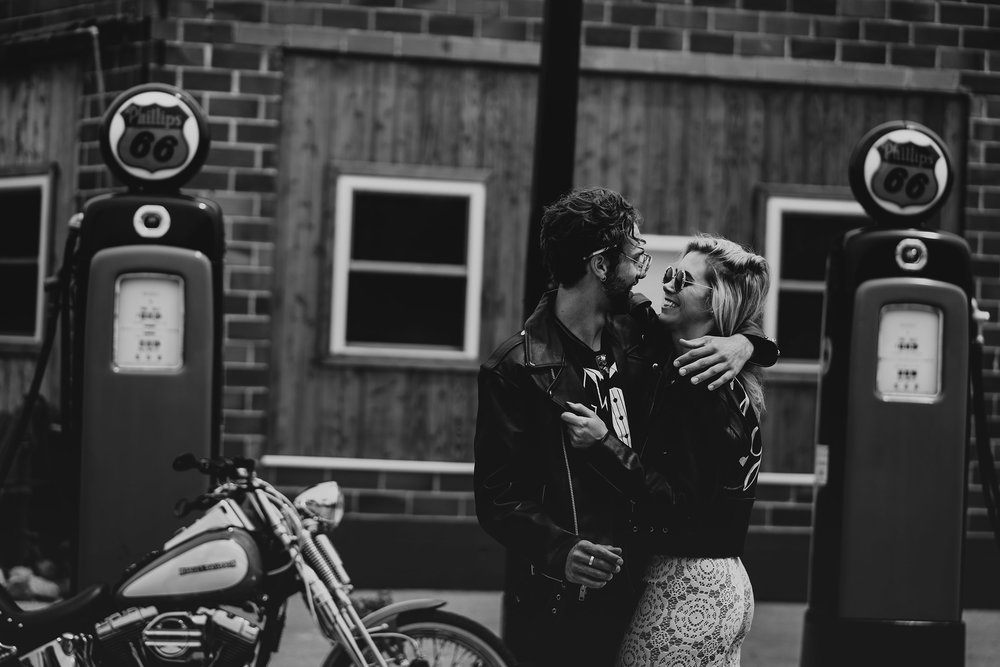 bride-groom-in-leather-jackets-at-gas-station-iowa-road-trip-romance-wedding-raelyn-ramey-photography-125.jpg