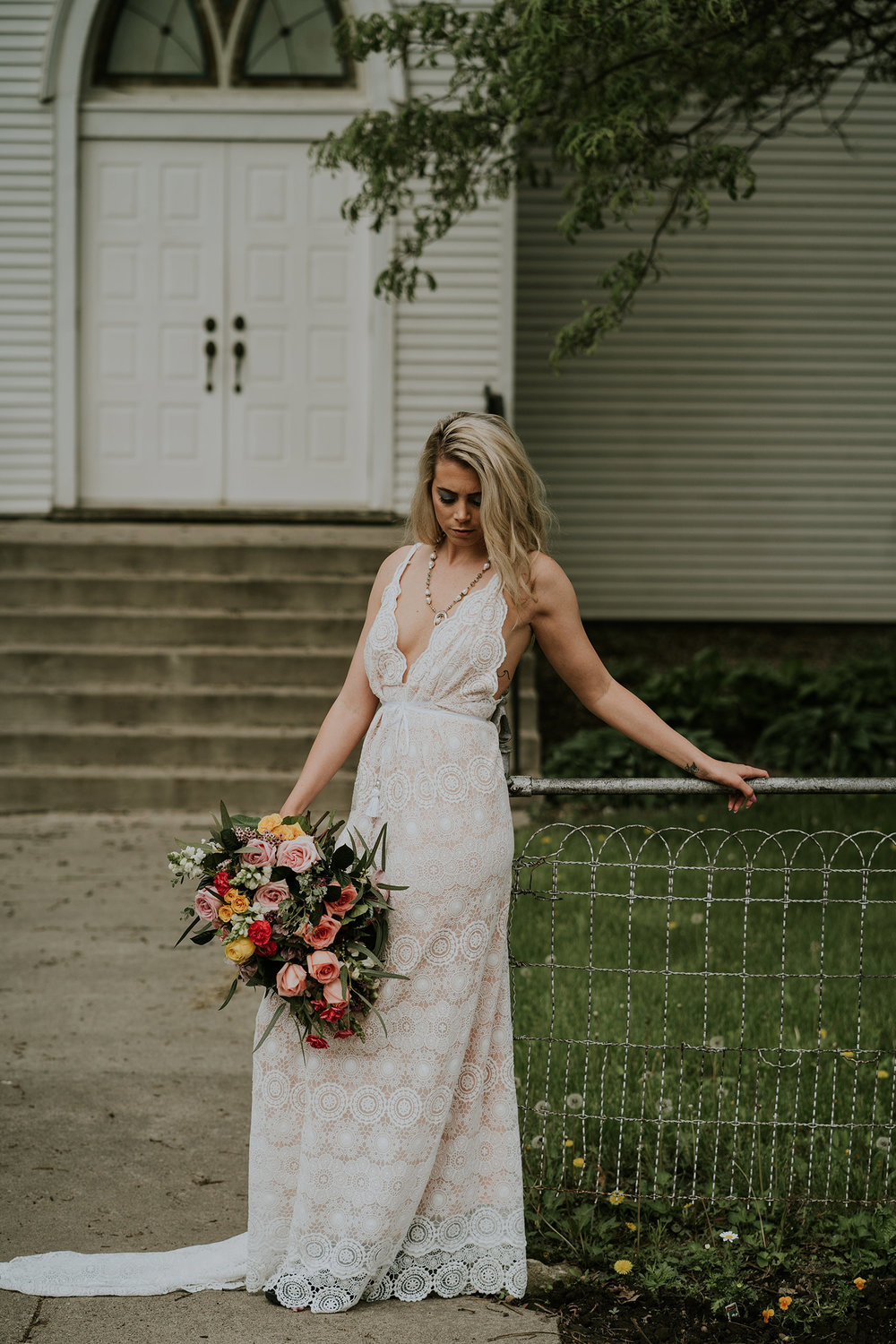 bride-wearing-dame-and-maiden-designs-iowa-road-trip-romance-wedding-raelyn-ramey-photography-8.jpg